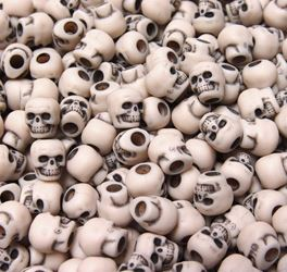 Antiqued Dark Ivory Skull Beads skulls,beads,crafts,head
